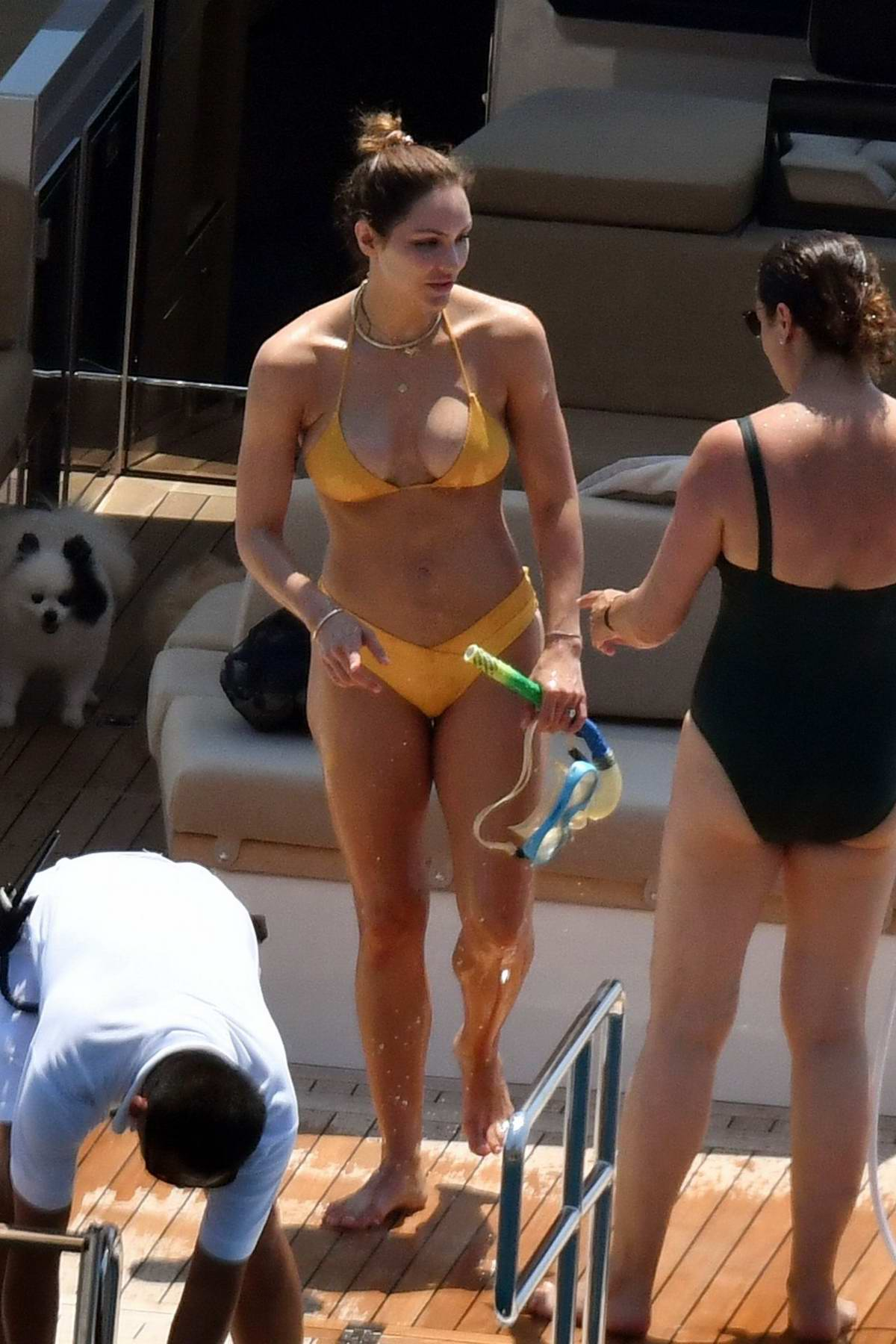 Katharine McPhee dons a yellow bikini while enjoying another day on a yacht in Capri, Italy