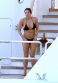 Katharine McPhee wears a black bikini on a yacht while enjoying her honeymoon in Capri, Italy