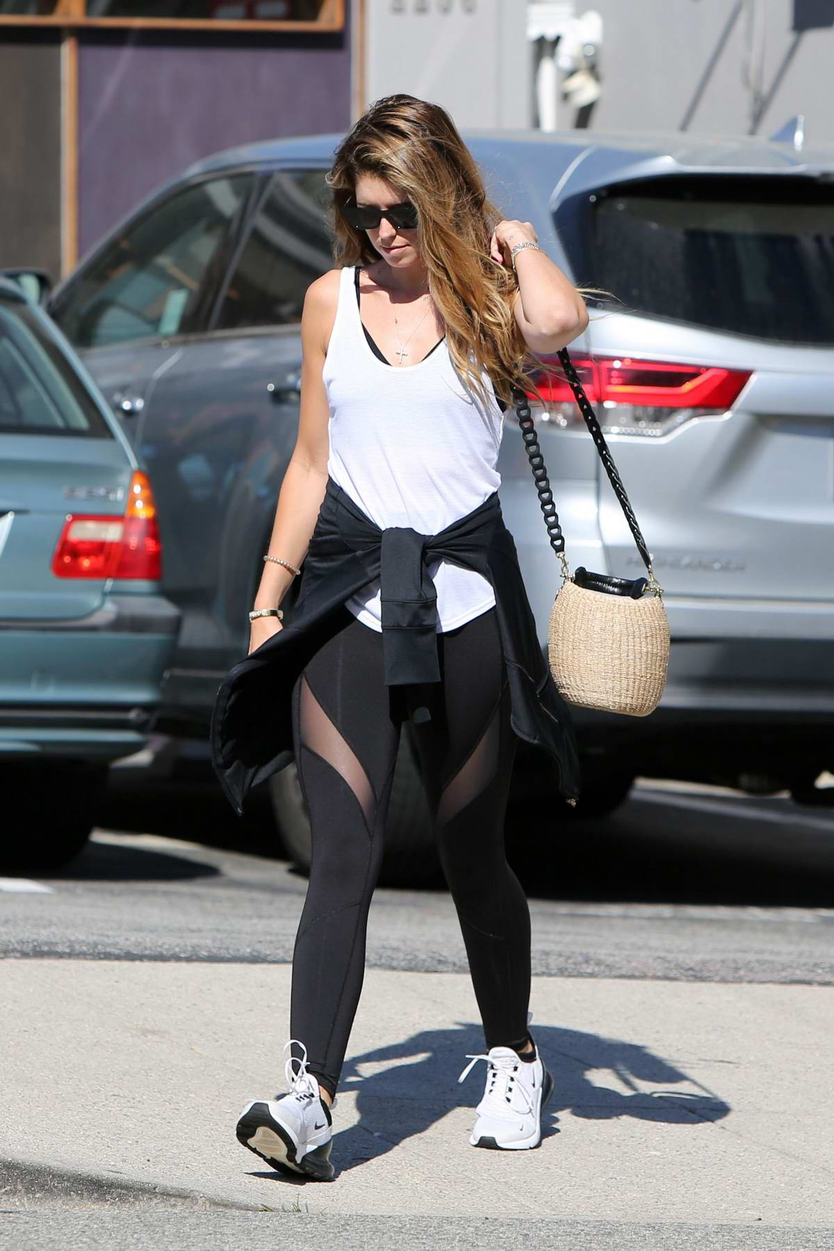 Katherine Schwarzenegger seen leaving after a workout session in a white tank top and black leggings in in Los Angeles