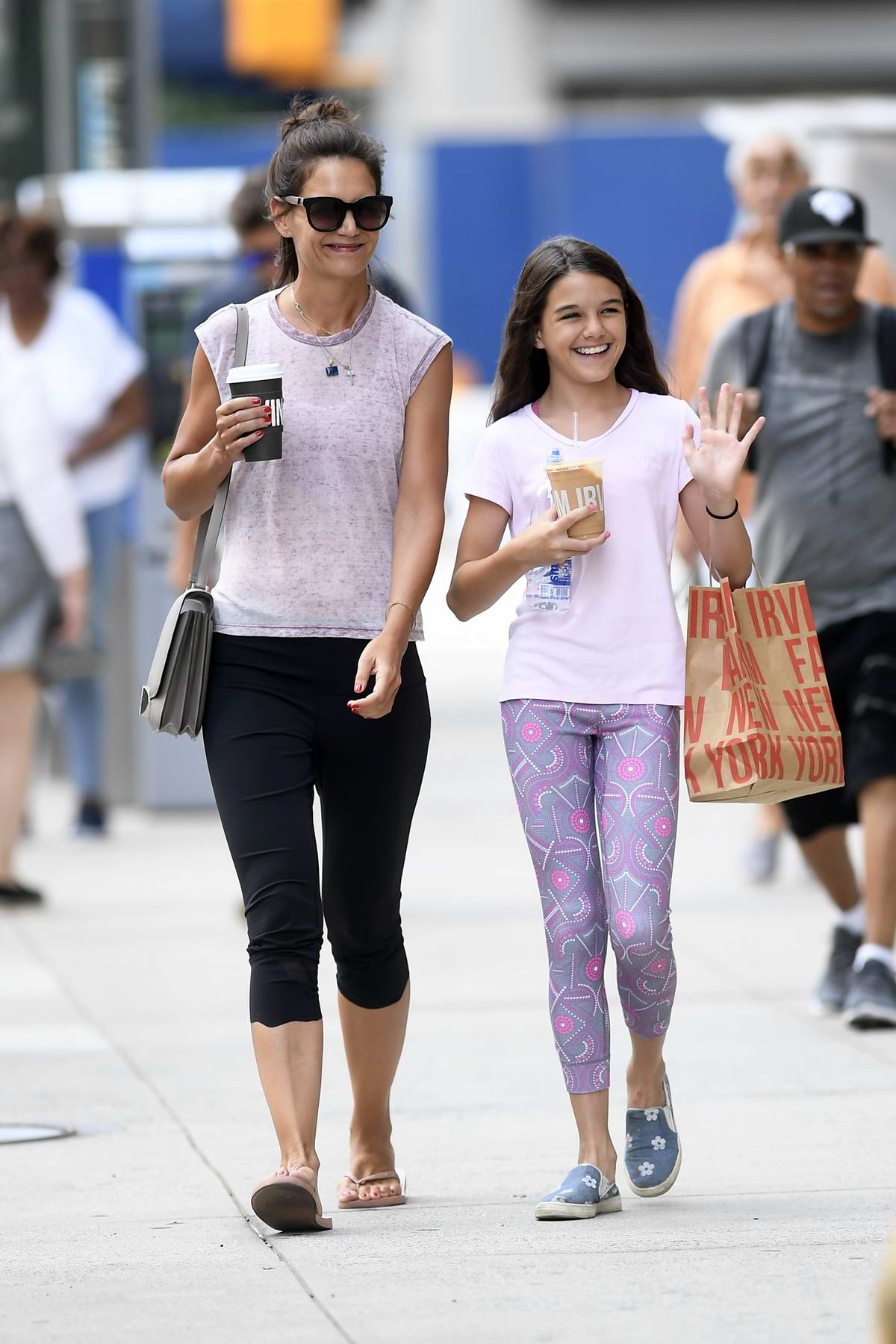 Katie Holmes and Suri Cruise are all smiles as they step out for stroll in New York City