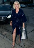 Katy Perry dons a navy vinyl trench coat as she arrives at Craig's for dinner in West Hollywood, Los Angeles