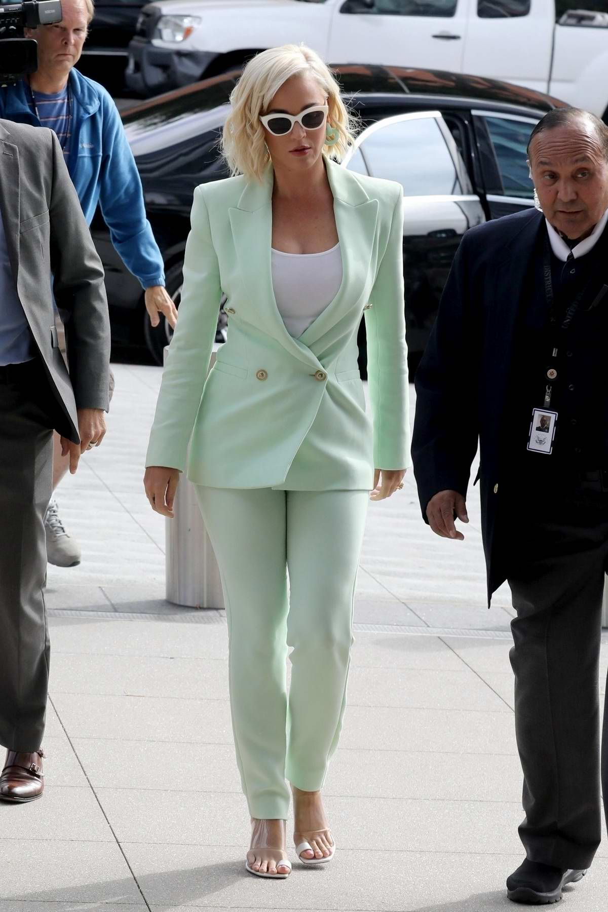 Katy Perry seen wearing a mint green suit while arriving at court for her copyright infringement lawsuit in Los Angeles