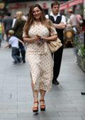 Kelly Brook looks adorable in a polka dot summer dress as she leaves Global Radio Studios in London, UK