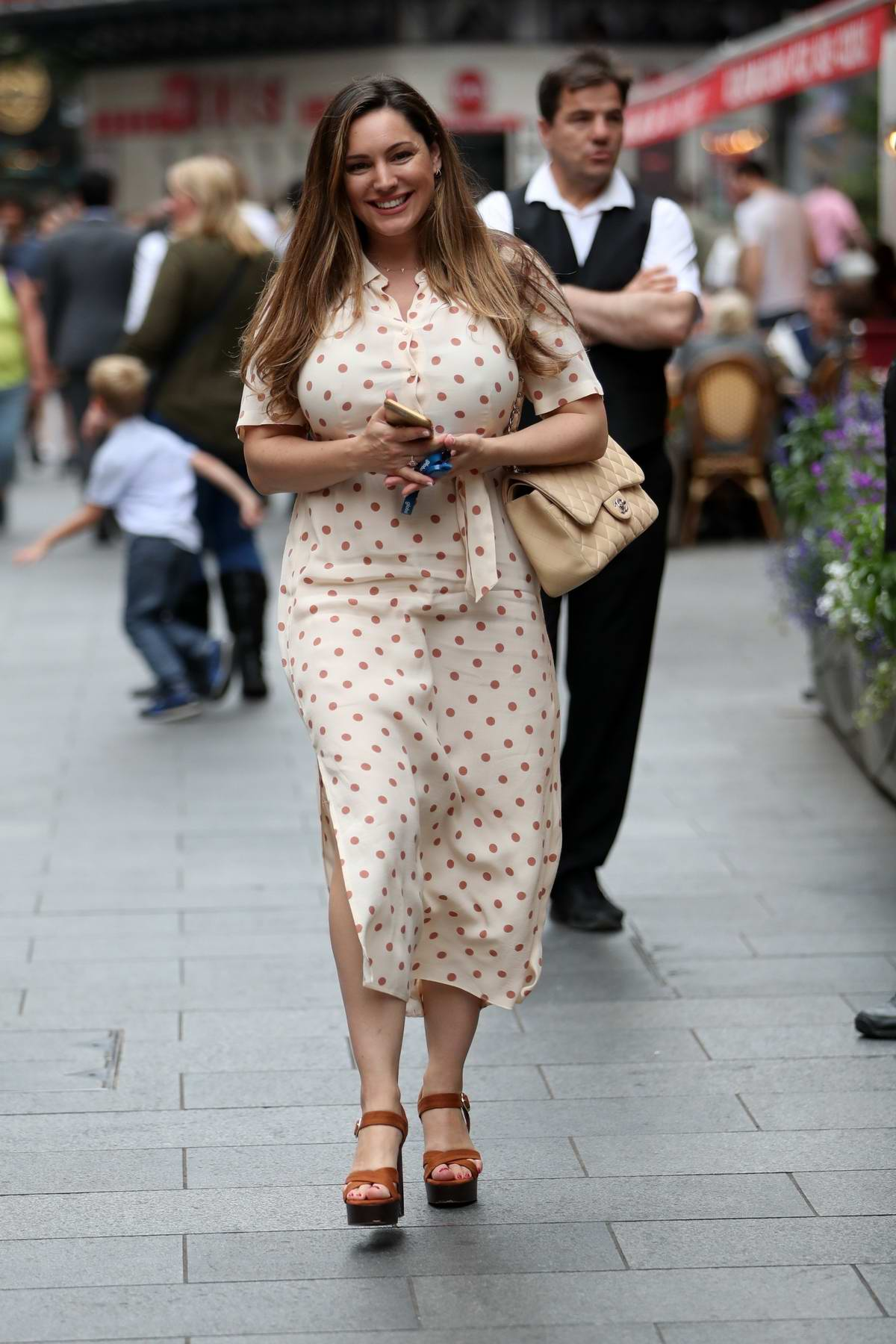 Kelly Brook looks adorable in a polka dot summer dress as she leaves Global Radio Studios in London, UK