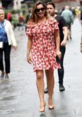 Kelly Brook looks amazing in a red floral minidress as she leaves Global Radio Studios in London, UK