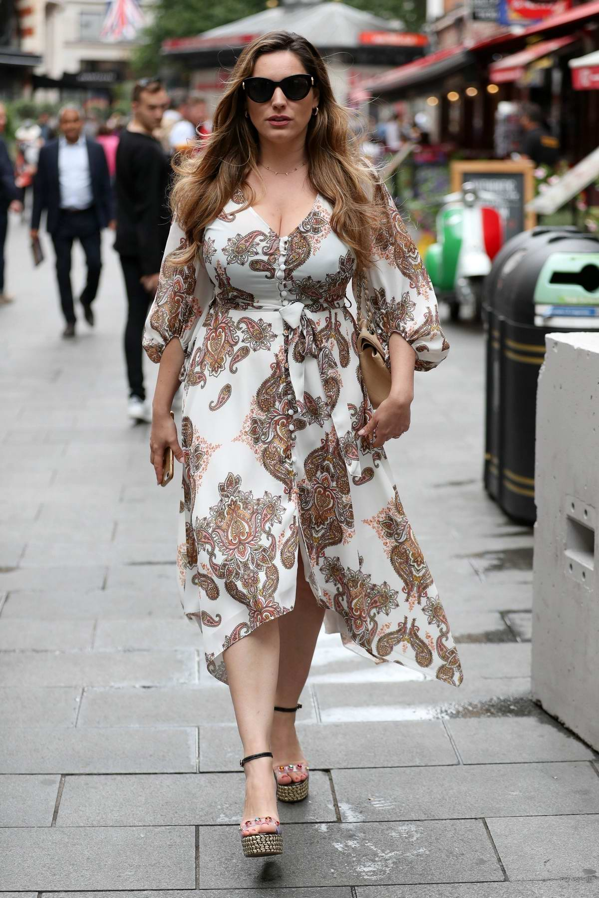 Kelly Brook looks elegant in paisley print summer dress as she leaves Global Radio Studios in London, UK