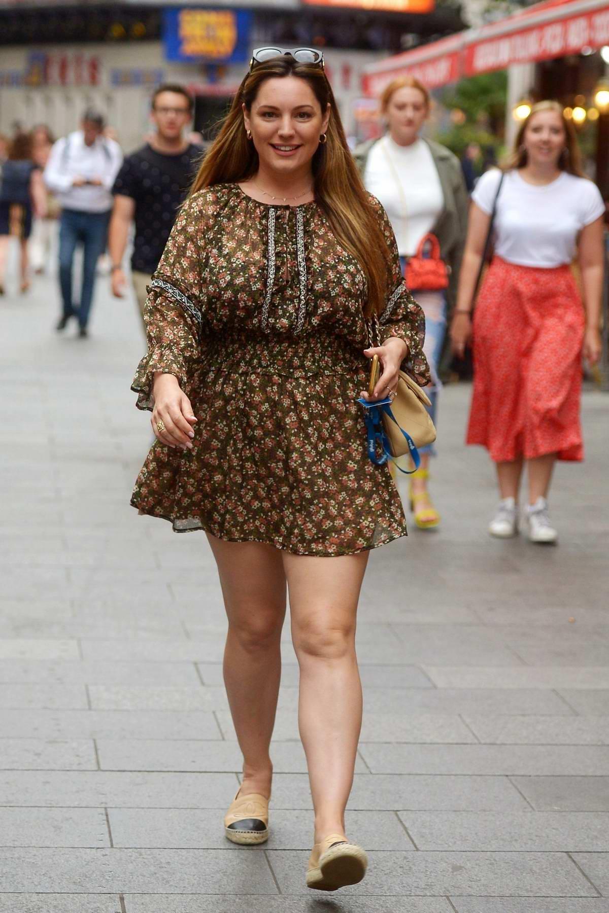 Kelly Brook looks pretty in a summer dress as she leaves Global Radio Studios in London, UK