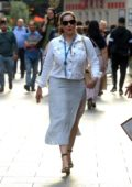 Kelly Brook seen wearing a white jacket and polka dot slit skirt as she leaves Global Radio Studios in London, UK