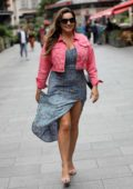 Kelly Brook stuns in a high split floral dress paired with a cropped pink jacket as she leaves Global Radio Studios in London, UK