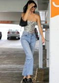 Kendall Jenner dons snakeskin top and jeans while heading for a business meeting in Beverly Hills, Los Angeles