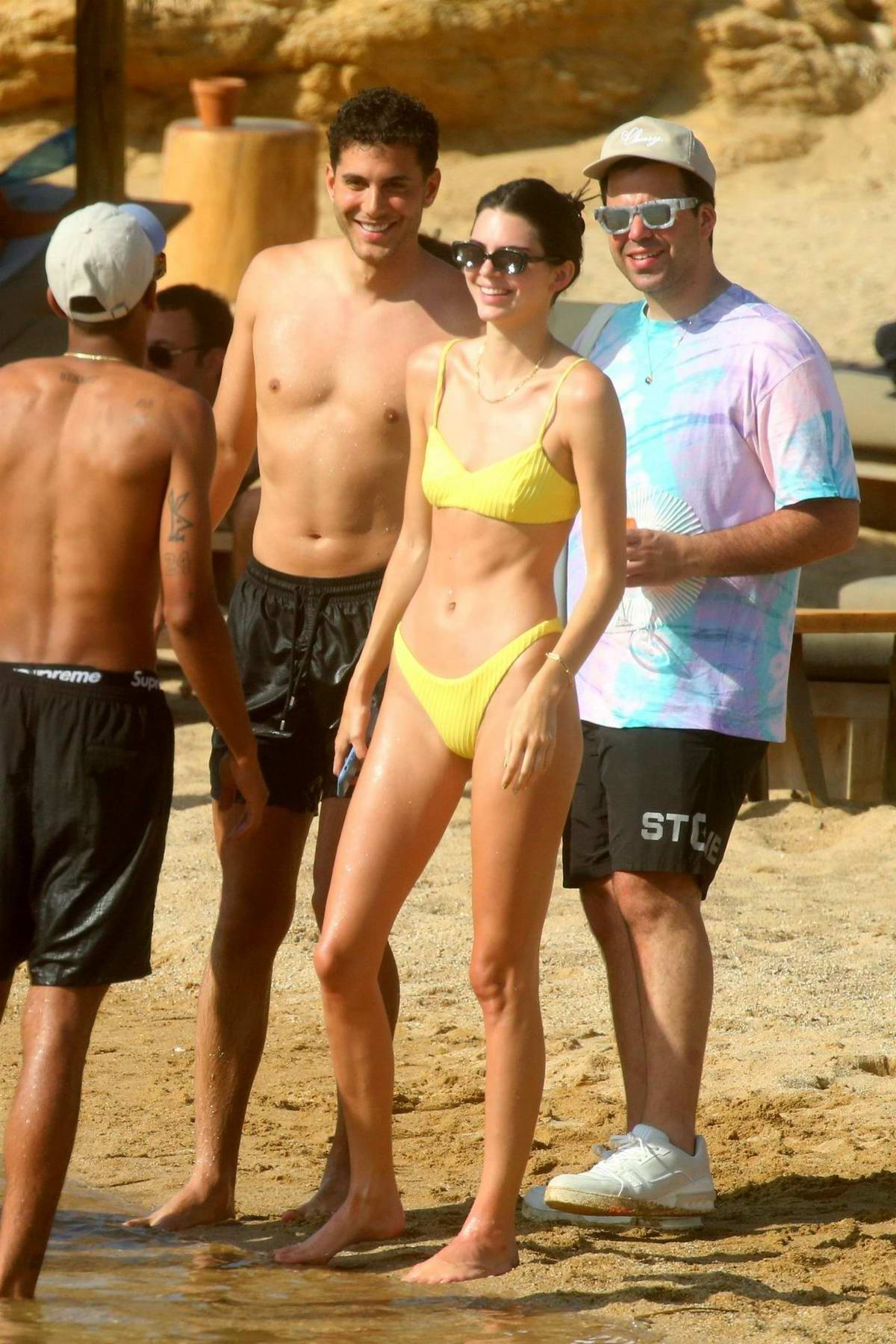 Kendall Jenner rocks a yellow bikini as she hits the beach with a group of friends in Mykonos, Greece