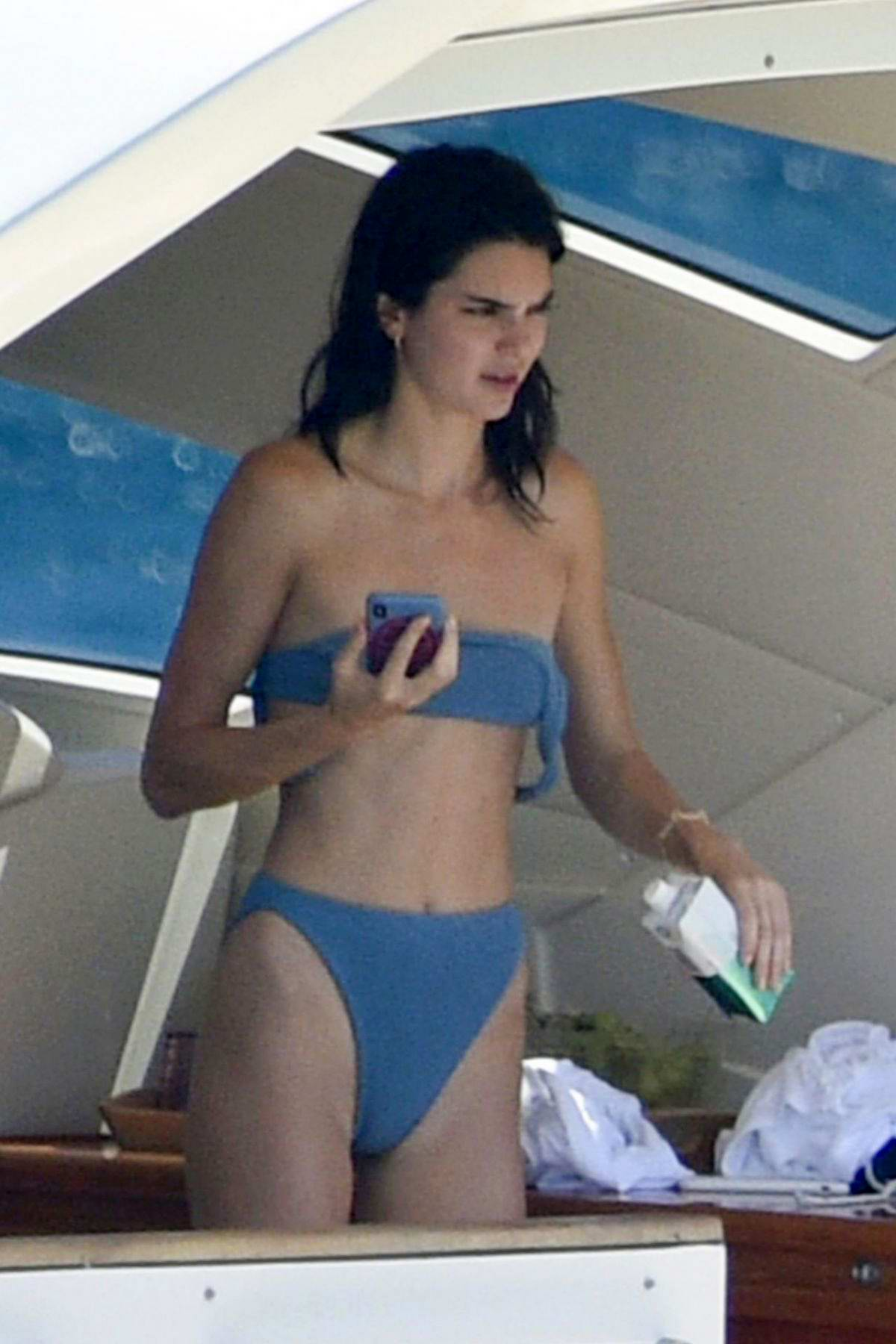 Kendall Jenner sports a blue bikini while relaxing on a yacht in Corsica, France