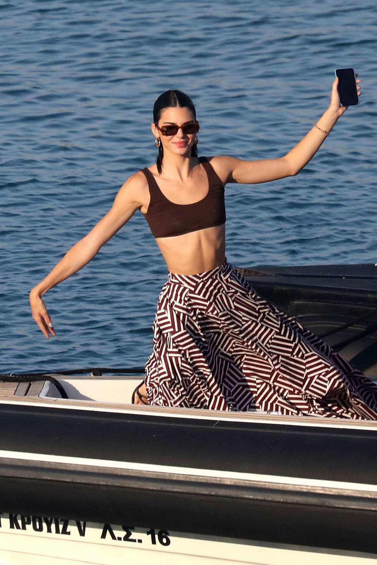 Kendall Jenner stuns in a brown crop top and patterned skirt while enjoying a boat ride in Mykonos, Greece