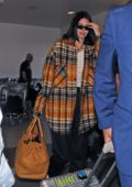 Kendall Jenner tries to avoid the camera as she arrives at LAX airport in Los Angeles