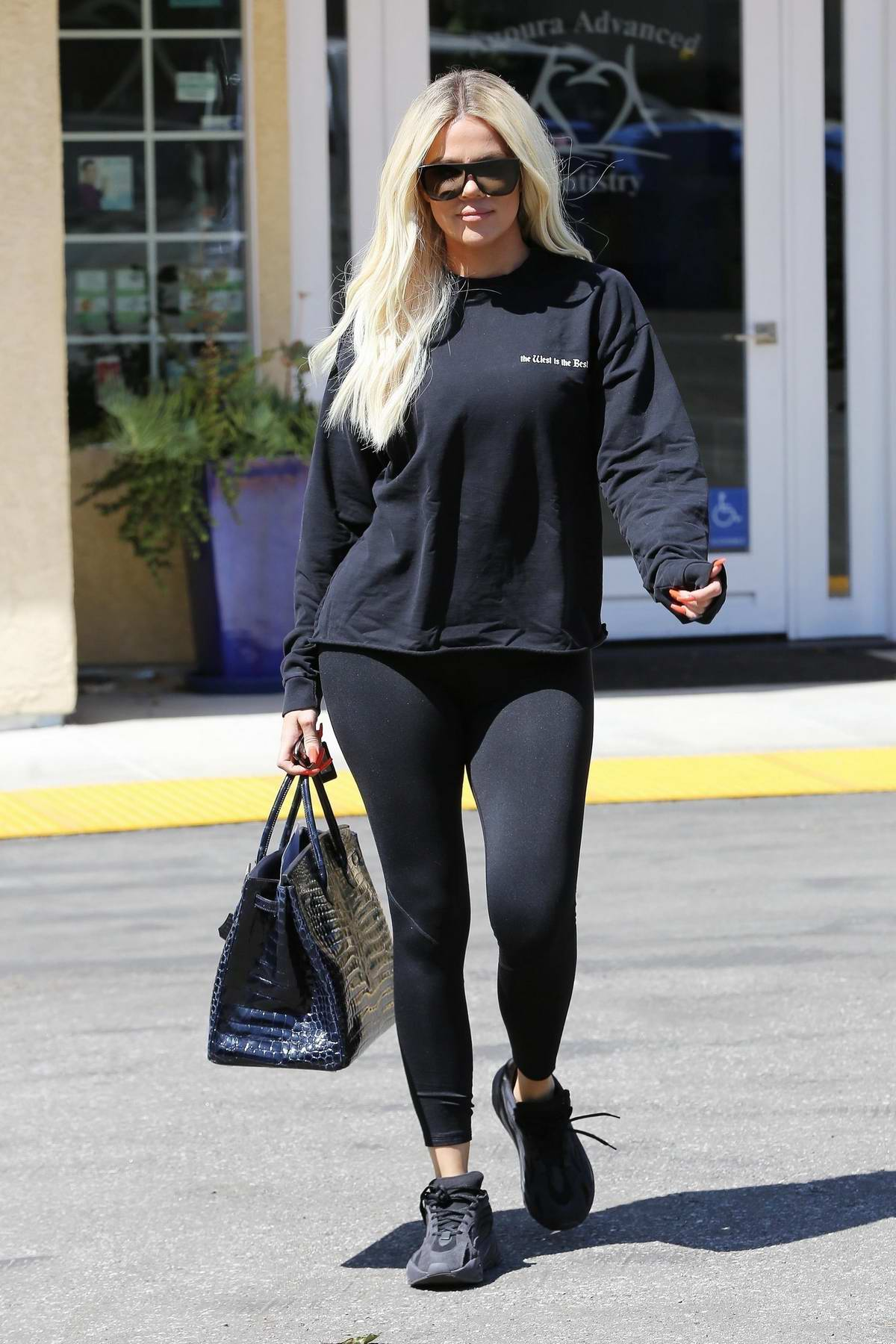 Khloe Kardashian dons all-black during a trip to the dentist office in Los Angeles
