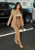 Kim Kardashian seen wearing a brown suit as she arrives at the White House in Washington D.C.