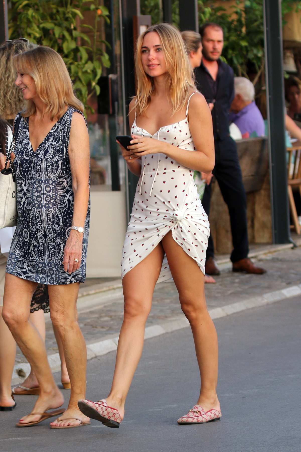 Kimberley Garner looks amazing in a white polka dotted minidress while out for a walk with her parents in Saint-Tropez, France