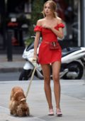 Kimberley Garner looks striking in red as she walked around the posh shops in Belgravia, London, UK
