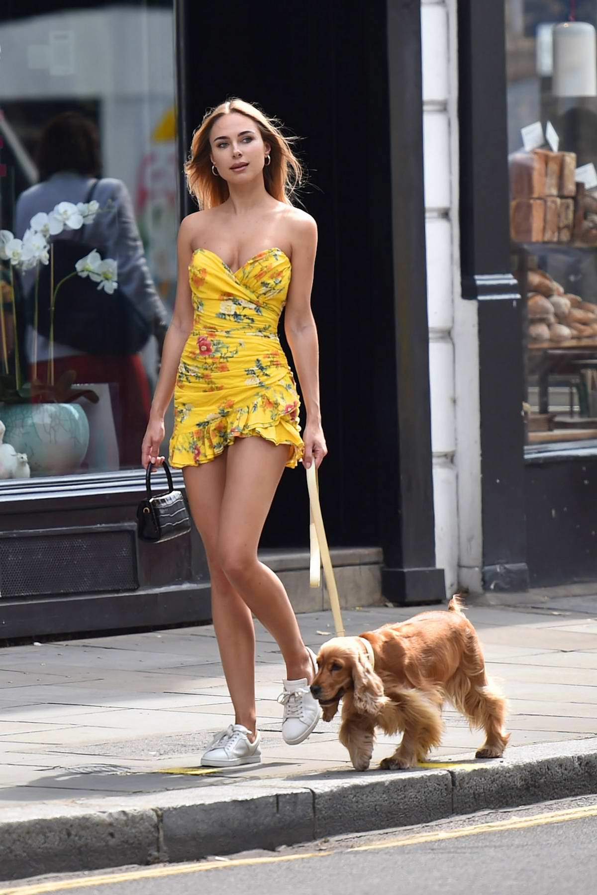 Kimberley Garner looks vibrant in a short yellow summer dress out in Chelsea, London