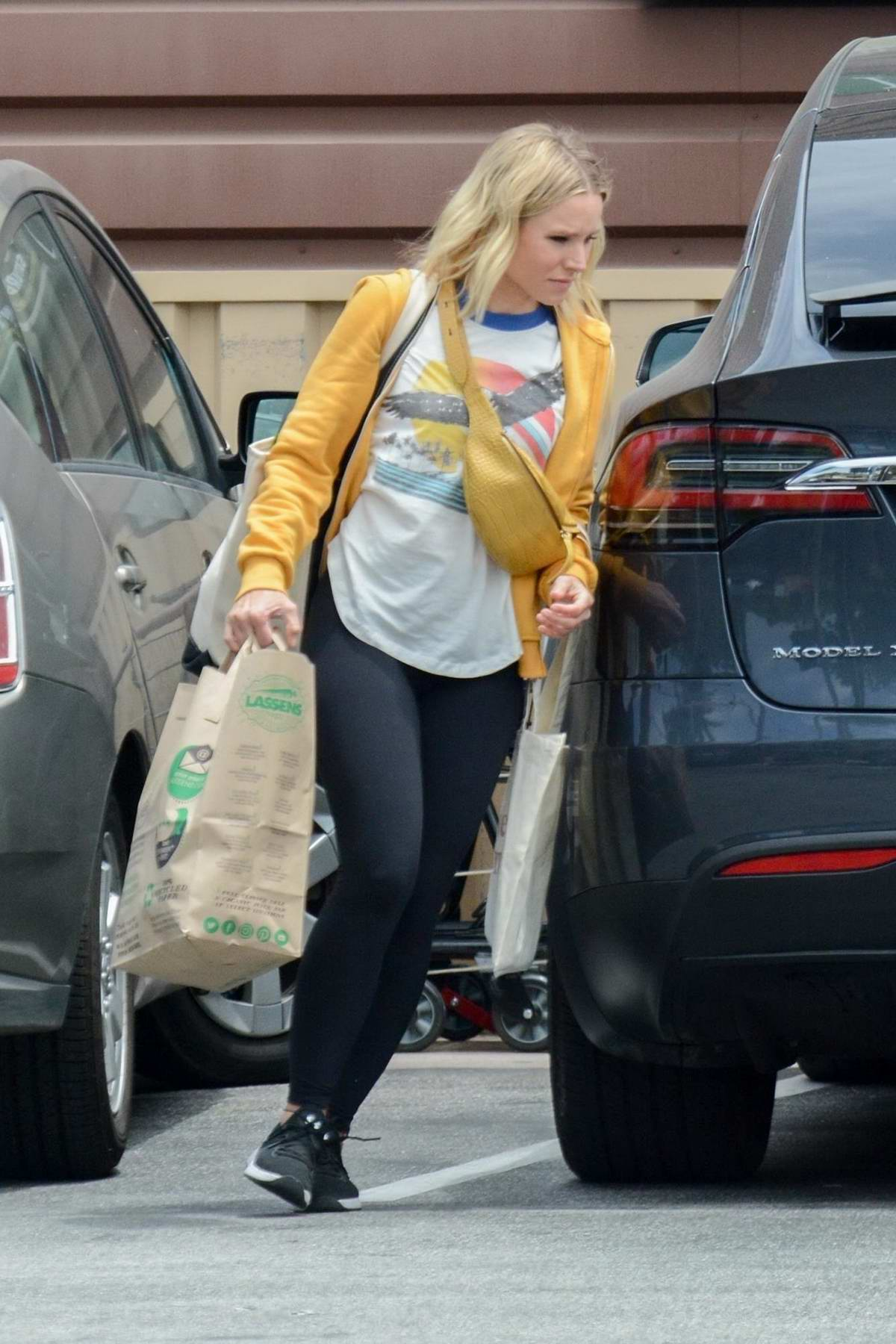 Kristen Bell spotted in yellow hoodie and black leggings while shopping groceries at Lassens in Los Angeles