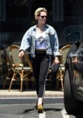 Kristen Stewart wears a white top with denim jacket and Adidas leggings while visiting a spa with a friend in Los Angeles