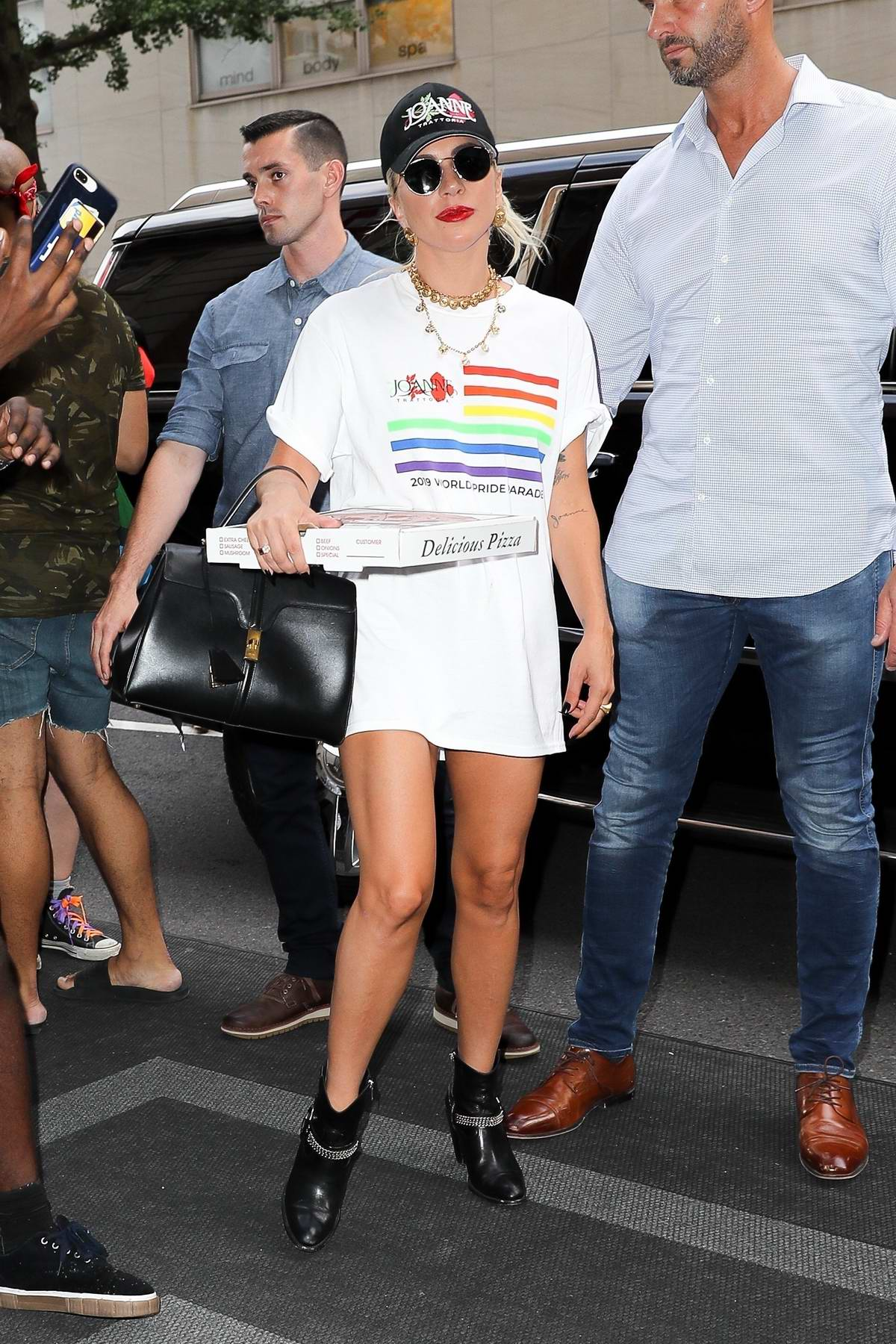 Lady Gaga holds a pizza box as she returns after making an appearance at the WorldPride event in New York City