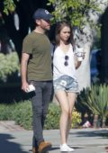 Lily Collins and Charlie McDowell wrap arms around each other while out for an afternoon walk in Los Feliz, California
