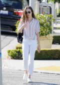 Lily Collins dressed in a striped shirt and white jeans while out in Beverly Hills, Los Angeles