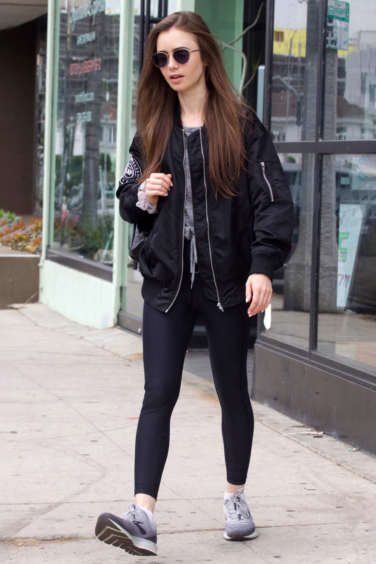 Lily Collins keeps it casual while out with a friend in West Hollywood, Los Angeles