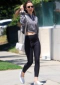 Lily Collins showcases her fit figure in black leggings and cropped hoodie while running errands in West Hollywood, Los Angeles