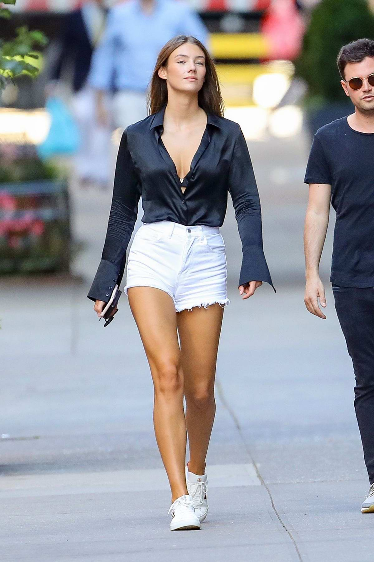 Lorena Rae keeps it stylish in a black shirt and white denim shorts as she steps out in New York City