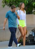 Lorena Rae rocks neon shorts and a white top while out in New York City