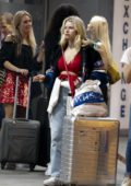 Lottie Moss grabs a quick smoke as she and her friends lands at Barcelona airport , Spain