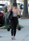 Lucy Hale shows off her toned figure in a crop top and leggings while heading for a late workout in Studio City, Los Angeles