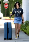 Lucy Hale spotted in a t-shirt and denim miniskirt as she heads out with her luggage in Beverly Hills, Los Angeles