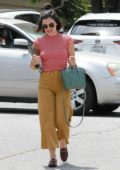 Lucy Hale wears a striped red top and mustard pants as she steps out for lunch at Harvest Moon in Los Angeles