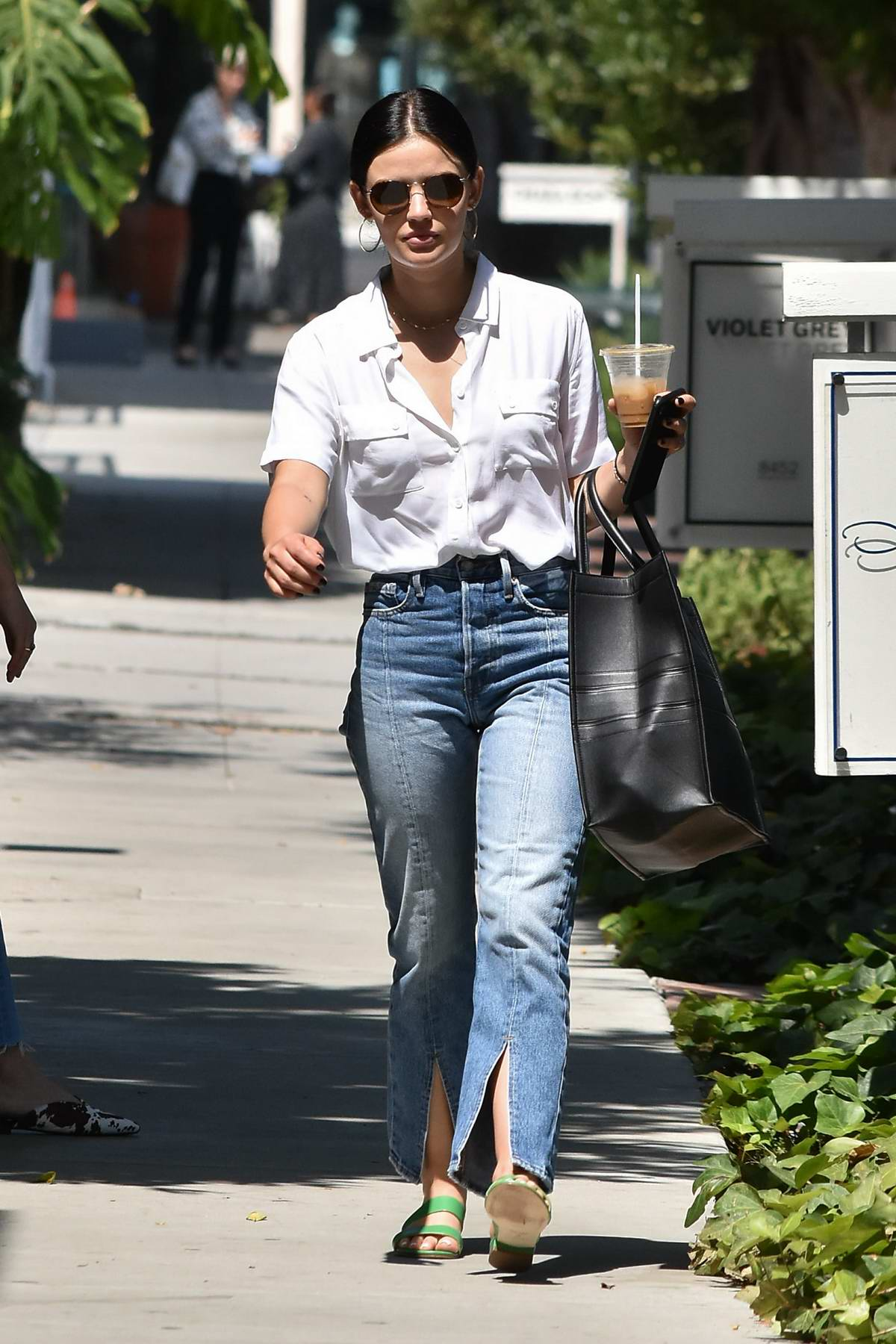 Lucy Hale wears a white shirt and flared jeans while running errands in Los Angeles