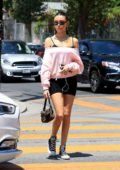 Madison Beer looks cute in a pink top and black legging shorts during a trip to a nail salon on Melrose Avenue in West Hollywood, Los Angeles