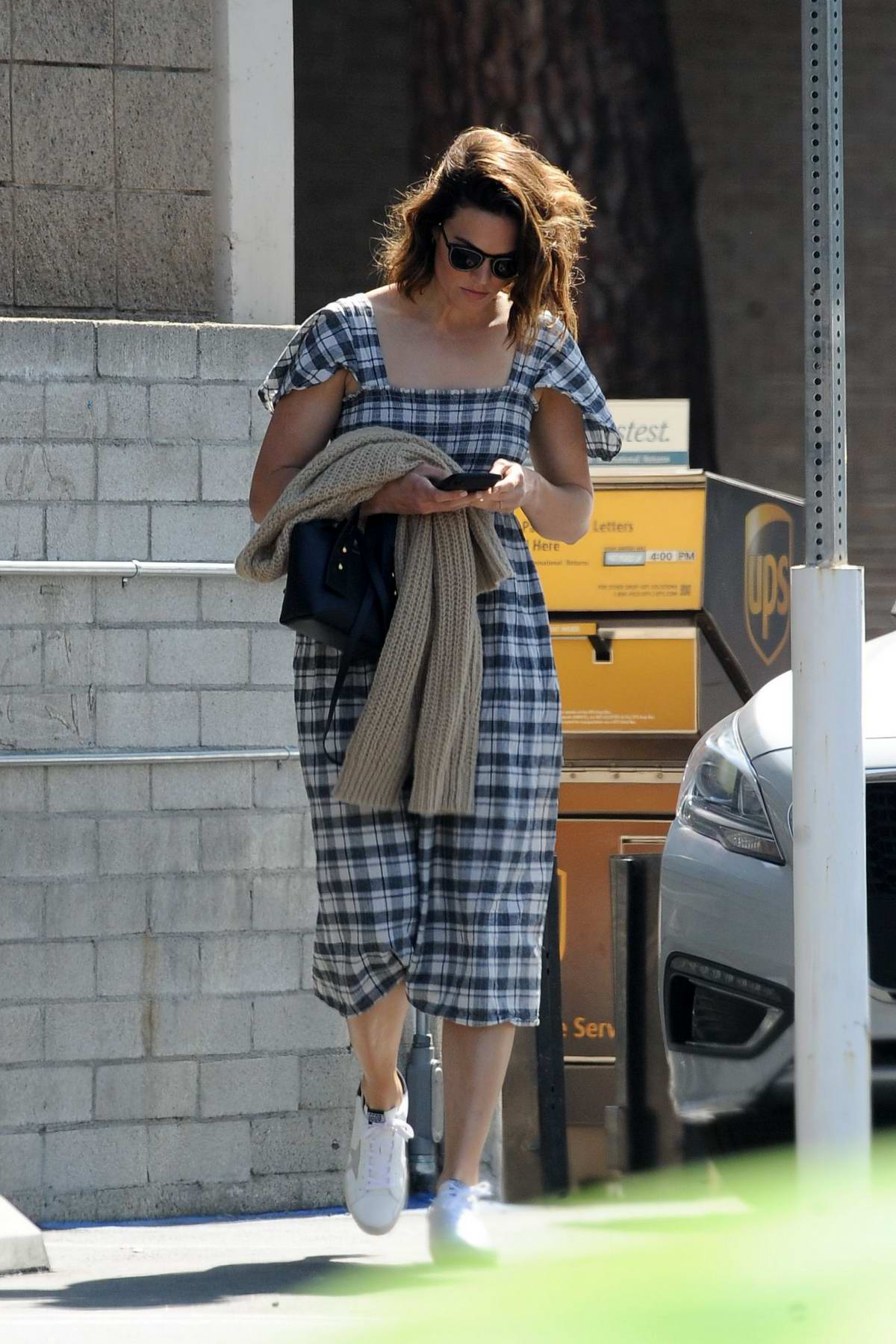Mandy Moore dons a plaid dress and Golden Goose sneakers for a solo outing in Los Angeles