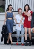Margaret Qualley is all smiles as she heads out with Kaitlyn Dever and her sister Rainey in Los Angeles