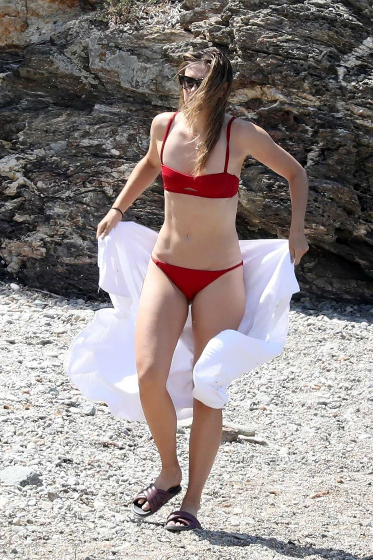 Maria Sharapova spotted in a red bikini while relaxing at the beach in Elba, Italy