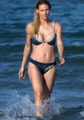 Michelle Hunziker sports a blue bikini during a beach day with her daughters in Milano Marittima, Italy