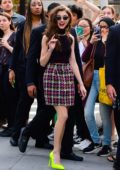 Natalia Dyer is all smiles as she arrives at AOL Build Studios in New York City