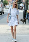 Nicky Hilton looks pleasant in a white summer dress as she steps out for a stroll in New York City