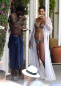 Nicole Murphy dons a colorful bikini while enjoying a dip in the pool with Antoine Fuqua at Regina Isabella hotel in Ischia, Italy