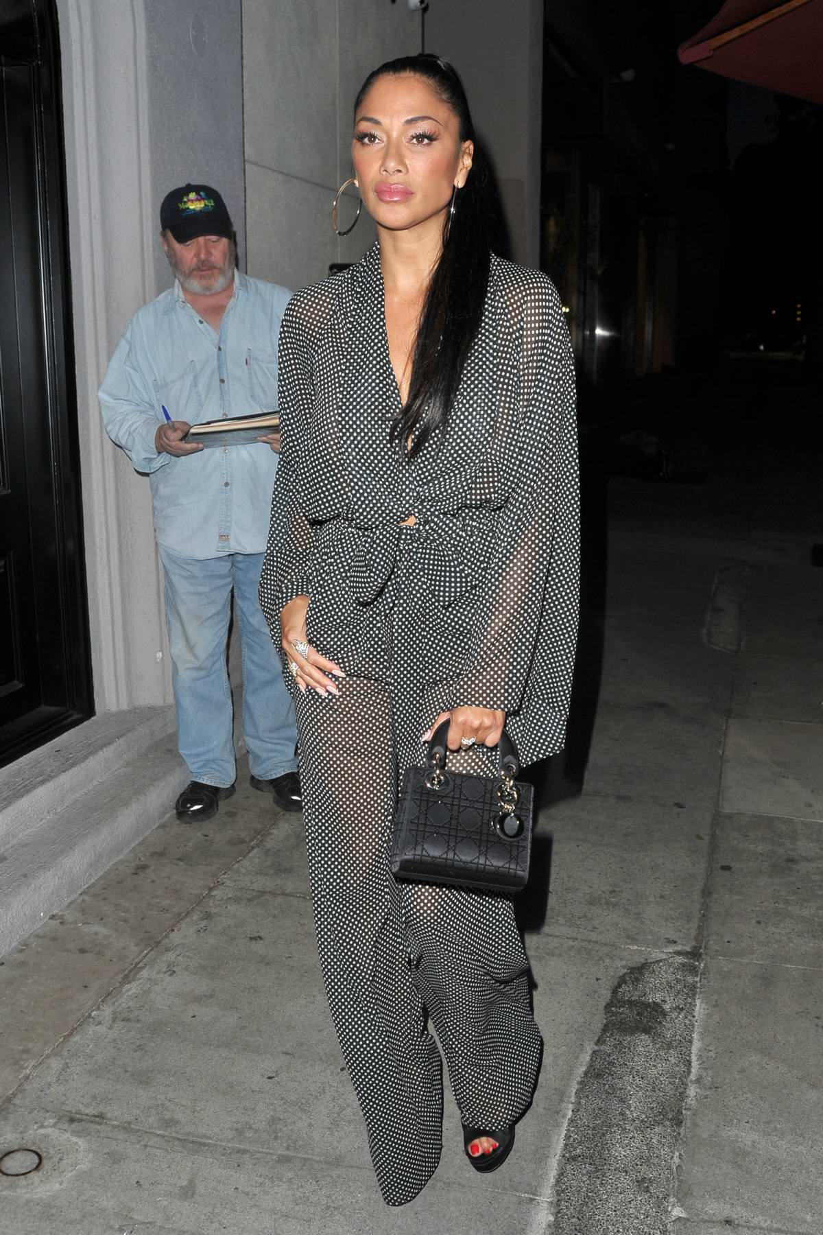 Nicole Scherzinger rocks a semi-sheer polka dotted jumpsuit as she arrives at Craig's in West Hollywood, Los Angeles