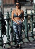 Nicole Scherzinger shows off her incredible figure in a sports bra and leggings while practicing her yoga in Sydney, Australia