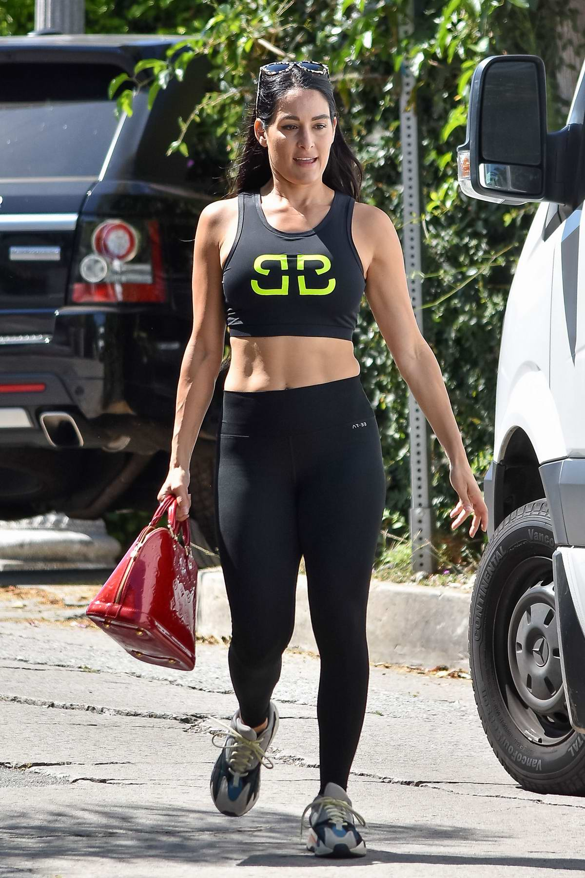 Nikki Bella shows off her fit body in BirdieBee tank, black leggings and Yeezys while out running errands in Los Angeles