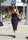 Nikki Bella steps out in a tight black dress as she leaves the hair stylist in West Hollywood, Los Angeles