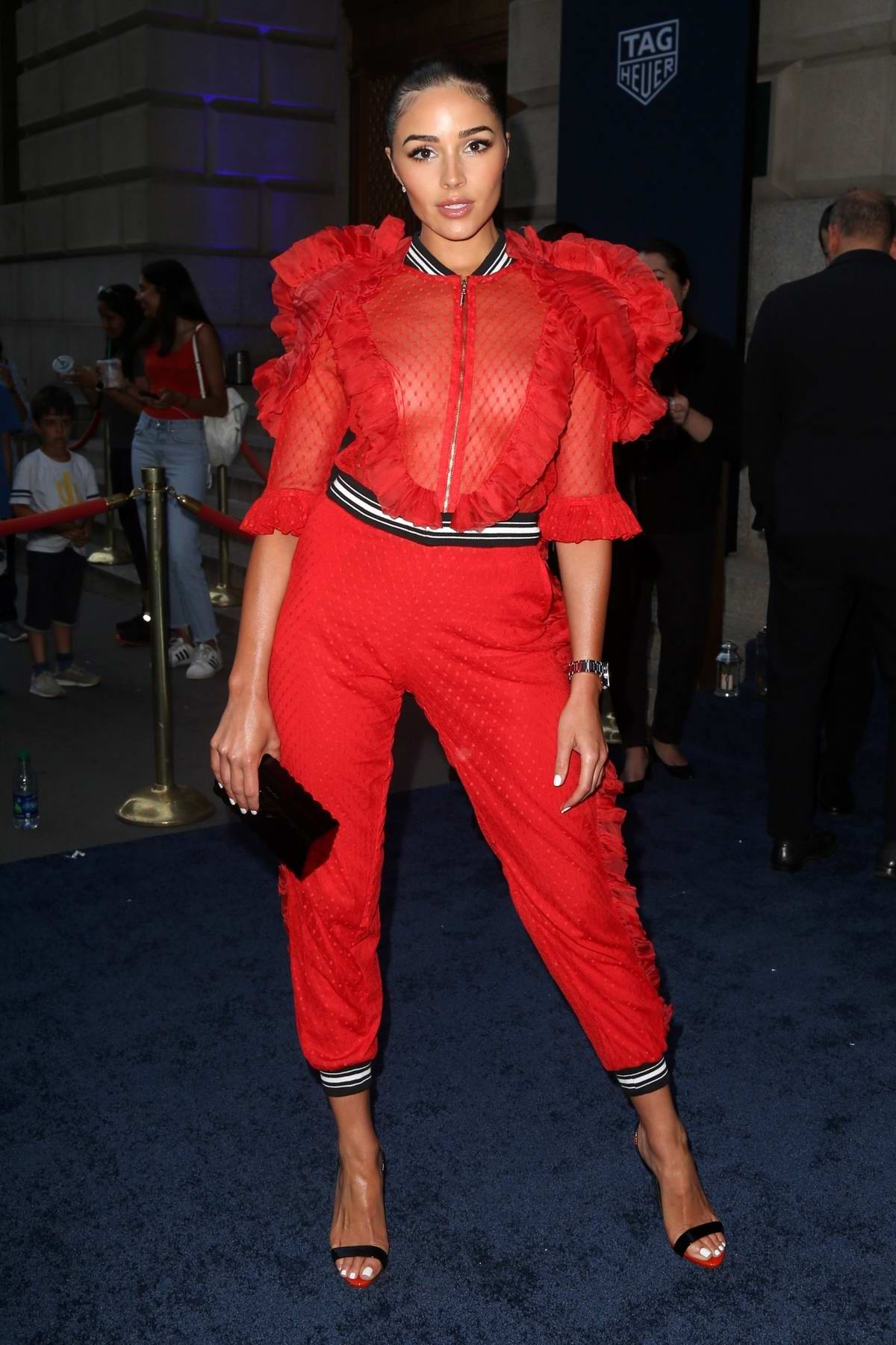 Olivia Culpo dazzles in red as she attends the Tag Heuer event in New York City